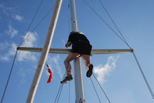 April 2012 Dream SeQueL Trip 161 -Jim in the bosun's seet being pulled up the mast